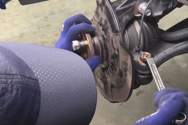 Wheel Bearing Replacement - In case the nut is rotating with the ball joint, press the ball joint further into the knuckle arm.